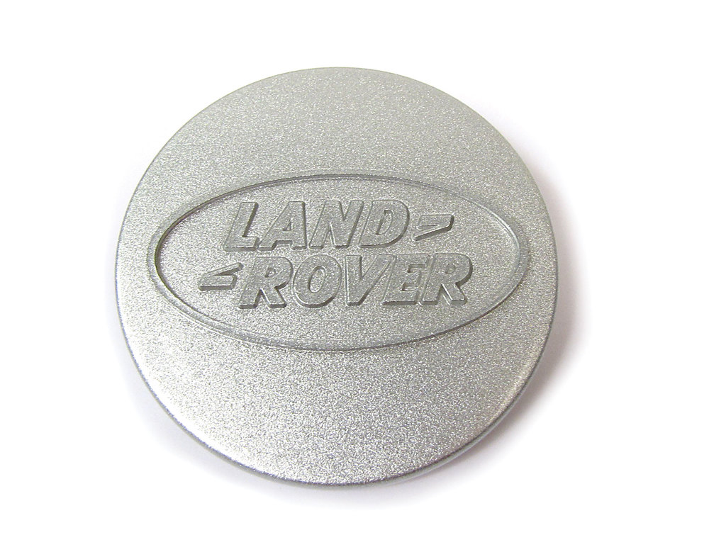 Genuine Wheel Center Cap ANR2391MNH, Silver With Land Rover Logo, For Land Rover Discovery I, Defender 90 And 110, And Range Rover Classic, Per Each (See Fitment Years)
