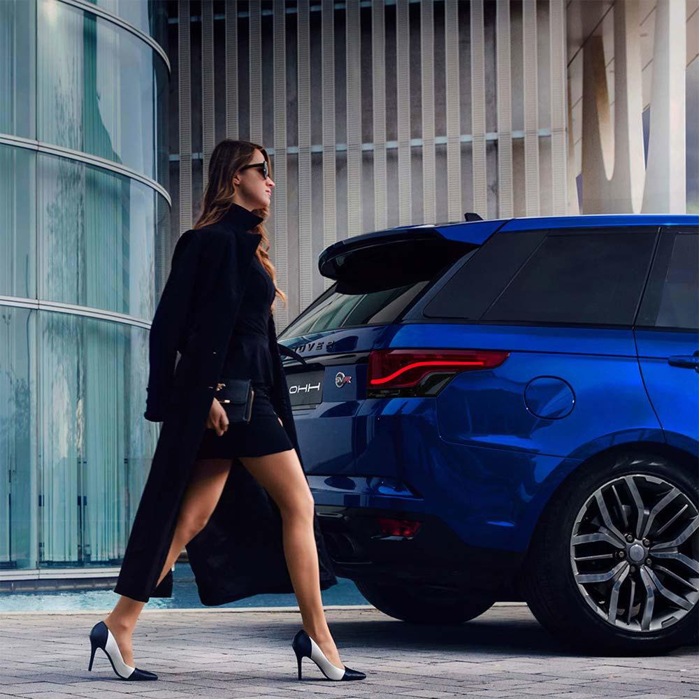 Glohh GL-5i dynamic LED tail light on Range Rover Sport, woman walking by