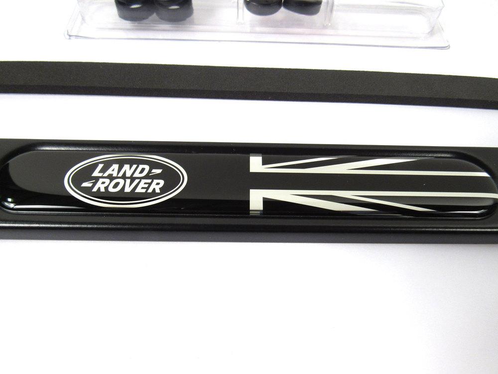 Genuine License Plate Frame, Land Rover Logo With Black Union Jack, Matte Black Finish