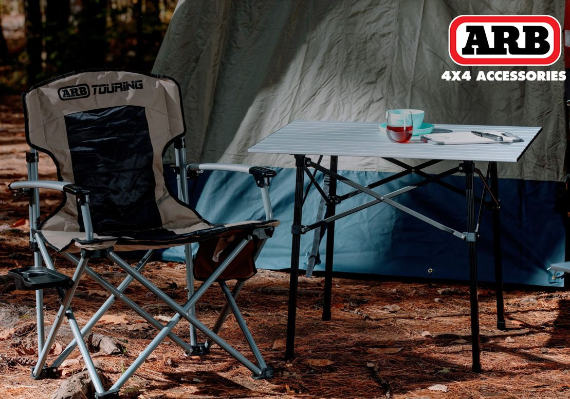 cozy camp set up with chair and folding table